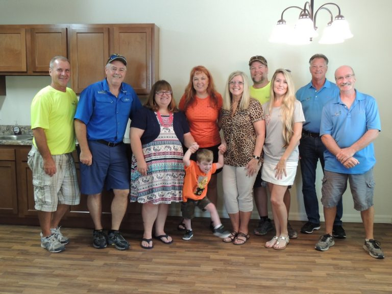 Group Photo incl. new home owners in kitchen